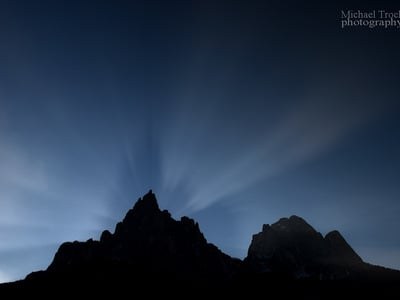 Lightning games of winter sun over Santner's Peak