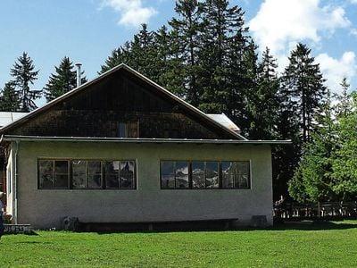 The Baita Tschafon (Tschafonhütte) mountain hut and Cima Völsegg (Völseggspitze) Peak