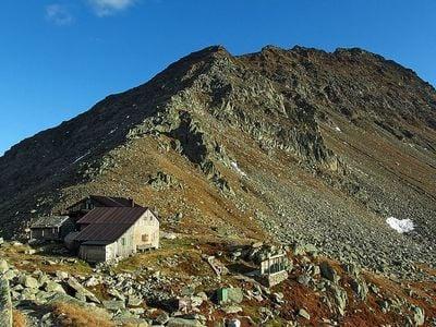 Rifugio Ponte di Ghiaccio (Edelrauthütte) mountain refuge and Cima Cadini (Napfspitze) Peak