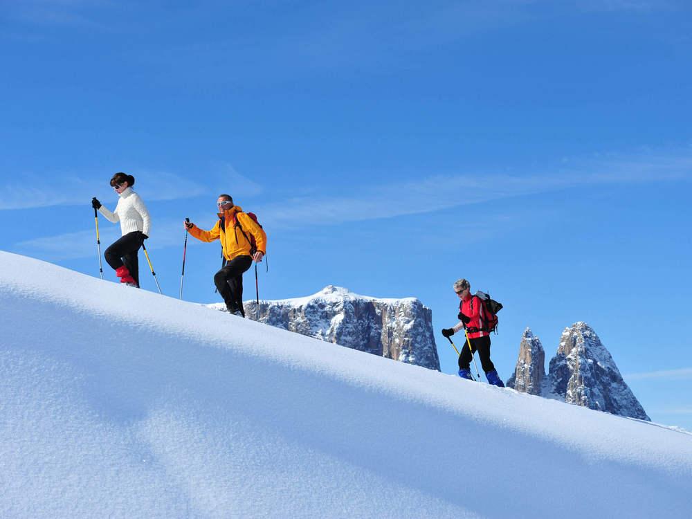 Snow shoe hiking on Alpe di Siusi - Dolomites