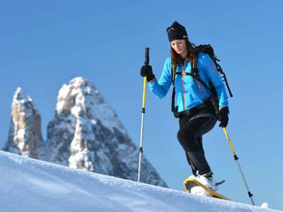 Snow shoe hiking and winter sun on Alpe di Siusi