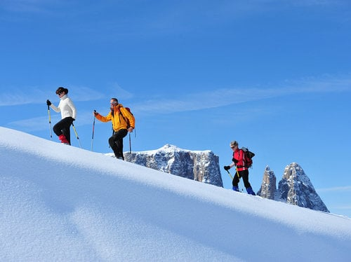 Snowshoe hiking on Alpe di Siusi