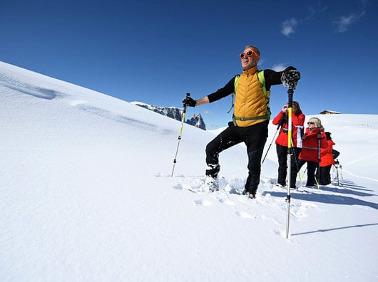 Snowshoe hiking on Alpe di Siusi
